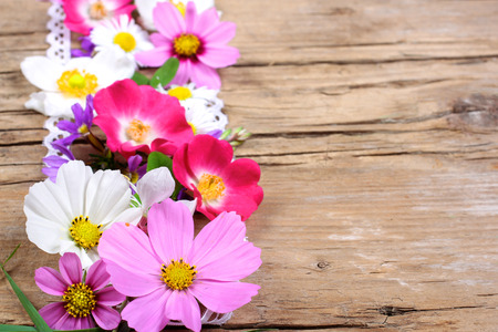 Table decoration with cosmos, roses and other flowers photo