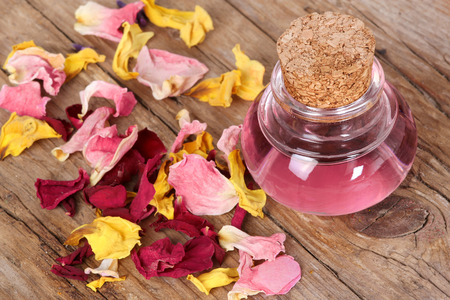 Rose petals with flask photo