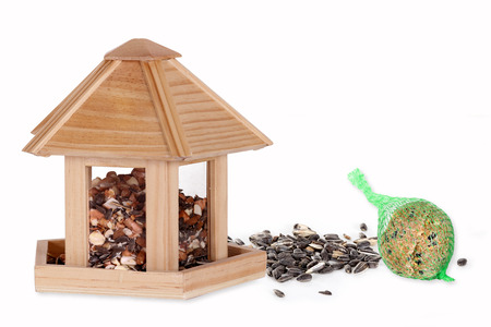bird feeder: Bird seed in a bird box with a fat ball