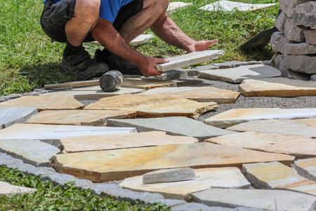 Worker with paver \\\\\\\\ 版權商用圖片