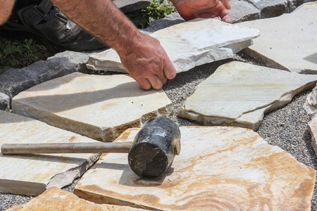 Worker with paver \\\\\\\\\\\\\\\\