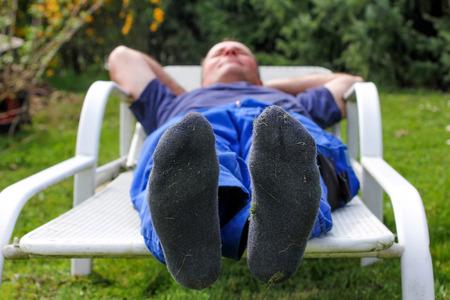 nonworking: Worker makes a break in the garden Stock Photo