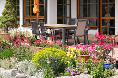 petunia: Terrace with garden furniture and rockery Stock Photo