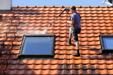 house cleaning: Roof cleaning with high pressure