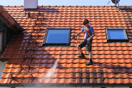 Roof cleaning with high pressure Banco de Imagens - 46002659