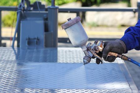 Working with paint spray gun Stockfoto