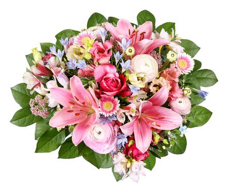 Ramo de flores con ranúnculos y lirios. Foto de archivo