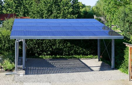 New carport with semi transparent photovoltaik moduls Stockfoto