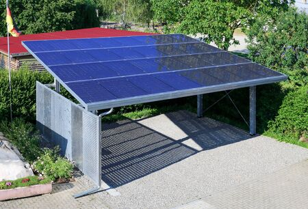 New carport with semi transparent photovoltaik moduls Фото со стока