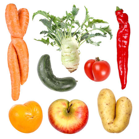 Deformed organic fruits and vegetables Standard-Bild