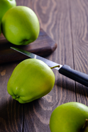 Fresh and juicy green apples on wooden background