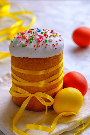 EasterFestive food. Easter cakes and colored eggs on a white table