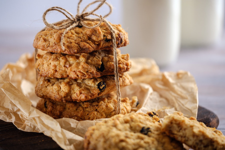 Healthy breakfast. Oatmeal cookies with milk on a wooden table