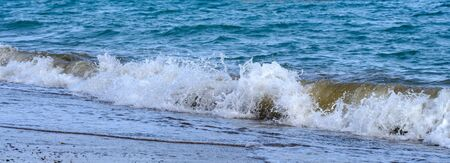 Panorama of waves of the sea close up