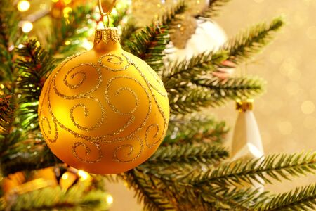 Gold Christmas balls on a gold background with bokeh