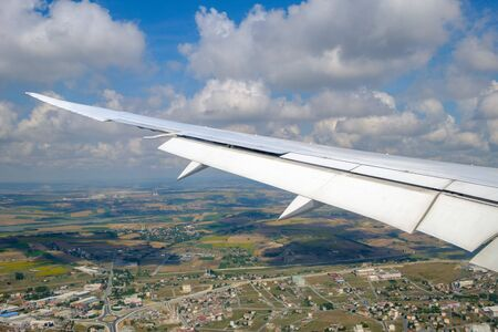 Istanbul. View of the wing of the aircraft and the clouds from the porthole. City view