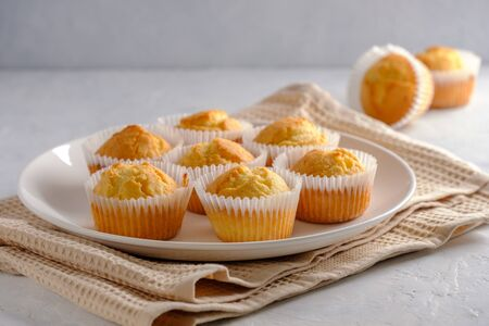 Delicate and delicious lemon cupcakes with crisp on a white plate