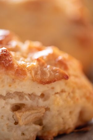 Homemade baking. Tasty, fragrant and tender scones with apples from the oven close-up