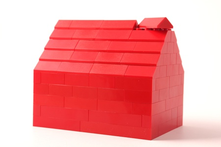 Red plastic house Stock Photo - 13394111