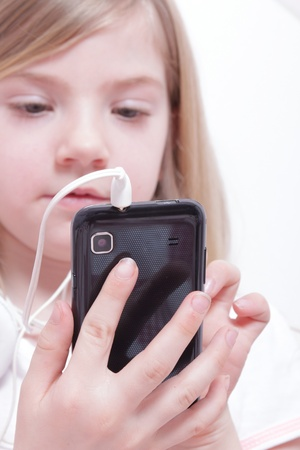 Young girl with phone Stock Photo - 13606067