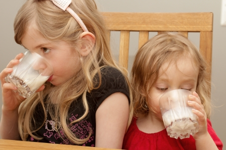 Girls drinking milk photo