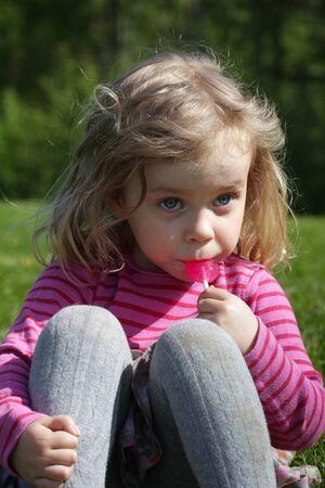 lolipop: Girl eating a lolipop