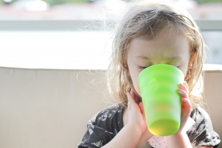 Young girl drinking milk Stock Photo - 14351779