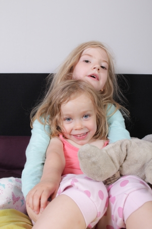 Girls playing in bed photo