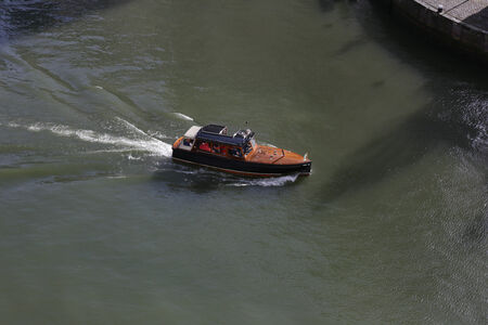 ferrying: Small boat ferrying passengers