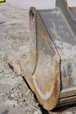 bilding: Part of excavator at a construction site