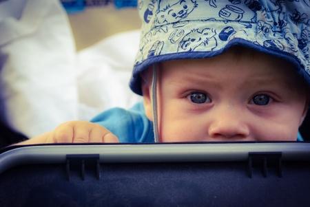 eye: A baby boy sitting in a stroller Stock Photo