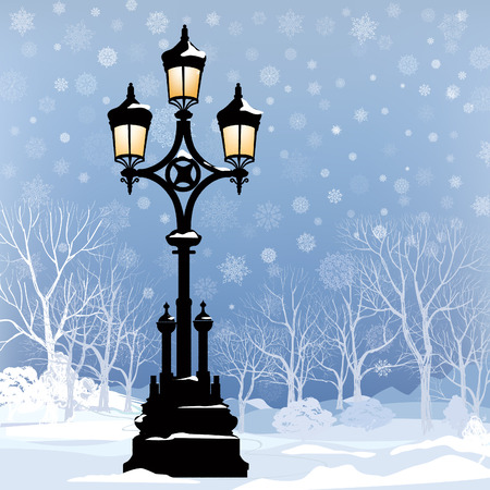Christmas Winter Landscape with luminous street lantern, snow flakes and trees. Old street light in park snow alley.