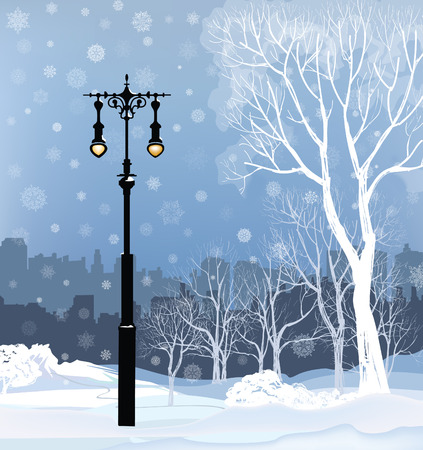 Christmas Winter Cityscape with luminous street lantern, snow flakes and trees. Old street light in city park snow alley.