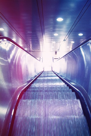 view of a staircase in a shop: escalator staircase