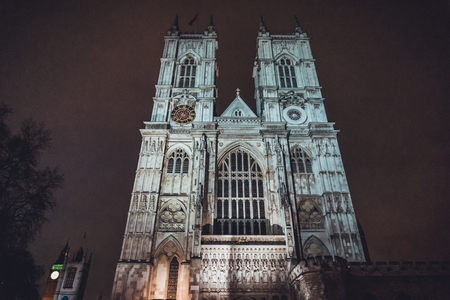 tourist attraction: Front facade of Westminster Cathedral illuminated at night, an iconic London landmark and tourist attraction Stock Photo