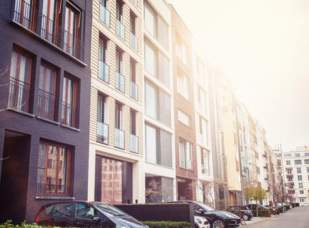 residential neighborhood: Neighborhood of luxury residential apartment buildings with parked cars on street with copy space Stock Photo