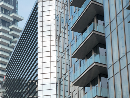close ups: Architectural Detail of Modern Urban High and Low Rise Buildings - Exterior Close Ups of City Buildings with Glass Facades and Balconies Stock Photo