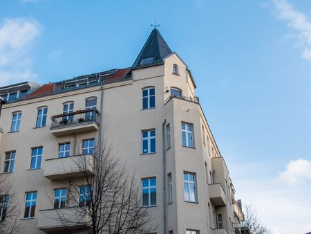 turret: Low angle corner view of residential apartment building with architectural turret on rooftop