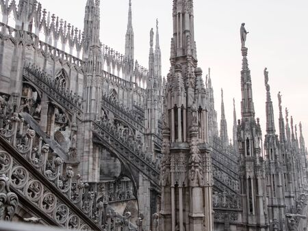 Architectural Close Up Of Historic Spires Milan Cathedral Church In Italian Gothic Style Dedicated