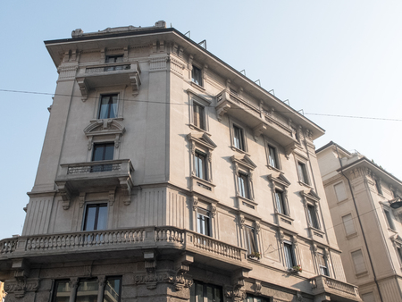 exterior architectural details: Low Angle Architectural Exterior View of Upper Residential Floors of Low Rise Building in Urban Environment with Classical Details on Day with Blue Sky and Bright Sunshine