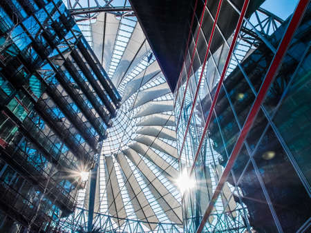 platz: Low angle interior view of sun coming through the ceiling of Potsdamer Platz Sony Center in Berlin