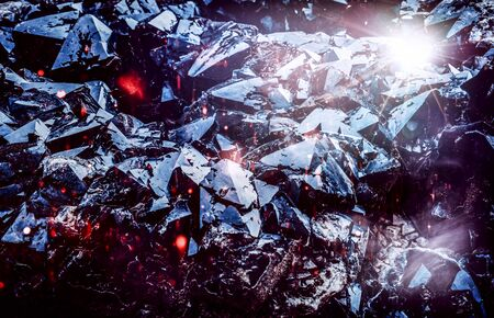 Fractured glassy black rock with hot embers as abstract nature or fantasy theme background