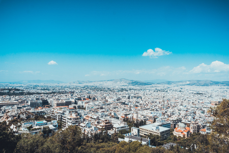 Aerial view over the rooftops of Athens, Greece, looking towards distant hills showing the topography of the ancient city and its environment