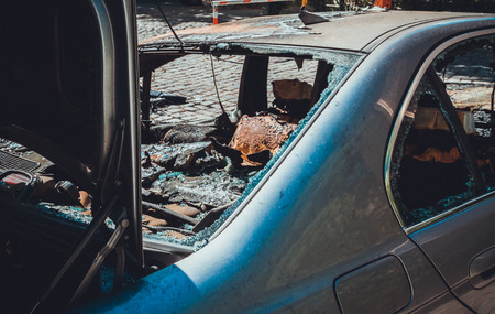 totally destroyed car after vandalism at berlin