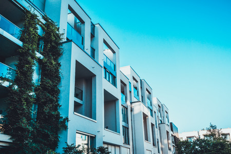 townhouses: modern townhouses in a row with blue sky Stock Photo