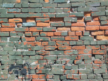 decaying: Painted Brick Wall Shows Wear