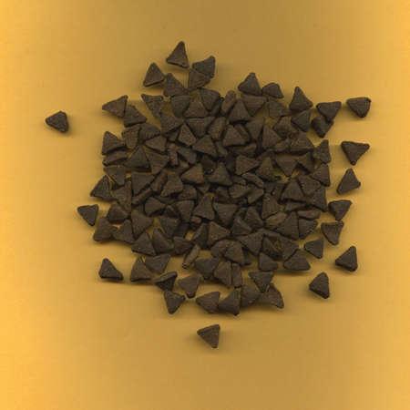 kibble: Triangular Cat Food Kibble Stock Photo