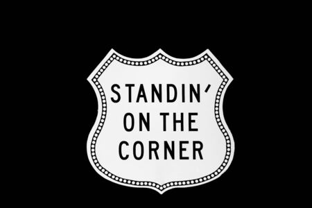 Standin on the corner sign at route 66 isolated on black