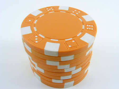 Stack of yellow poker chips on a plain background