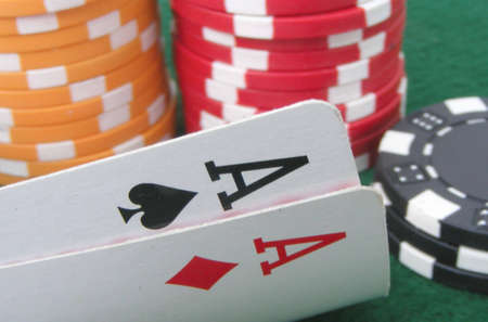 Pair of aces with chips in background